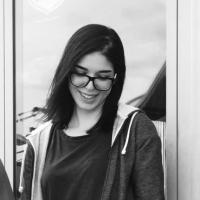Girl wearing glasses, black and white image