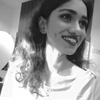 its is a monochrome picture of me smiling, i'm not looking at the camera tho:)