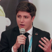 Alex Garcia speaking on the topic of his work on immigration at the 2019 HLPF summit in NYC.