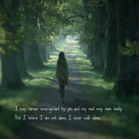 A girl walking alone in a road, trees by its both sides. Below her, it is written : I may remain unrecognized by you and my road may seem lonely. But I believe I am not alone. I never walk alone.