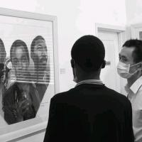 A picture of me and a China citizen while I'm explaining my art to him in an exhibition